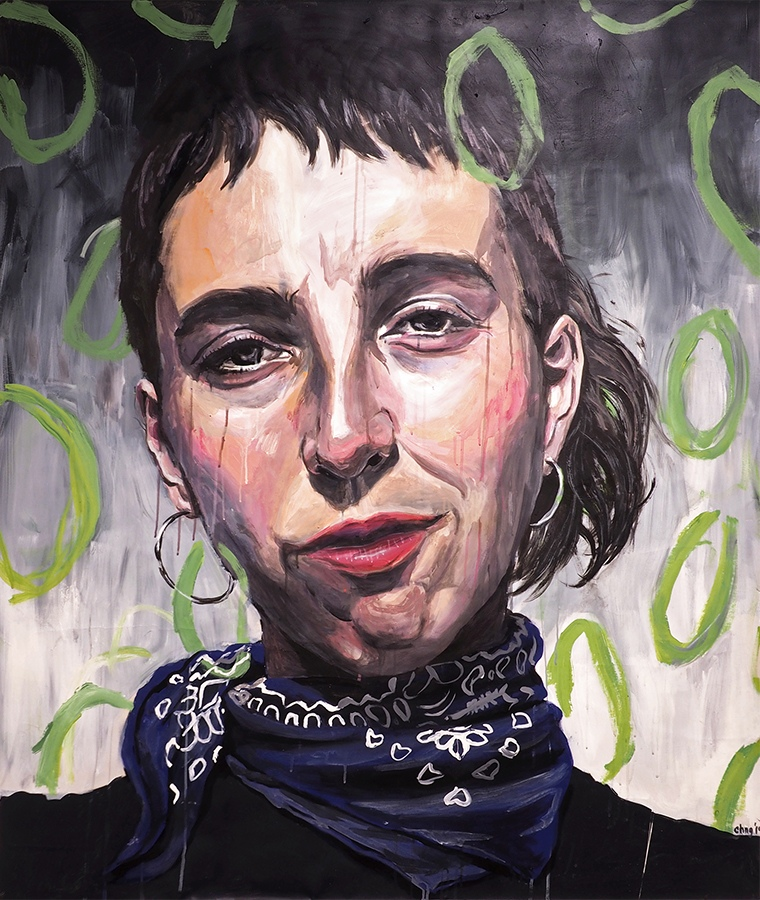 portrait of androgynous person with hoop earring and neck scarf