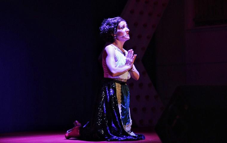 woman praying while kneeling