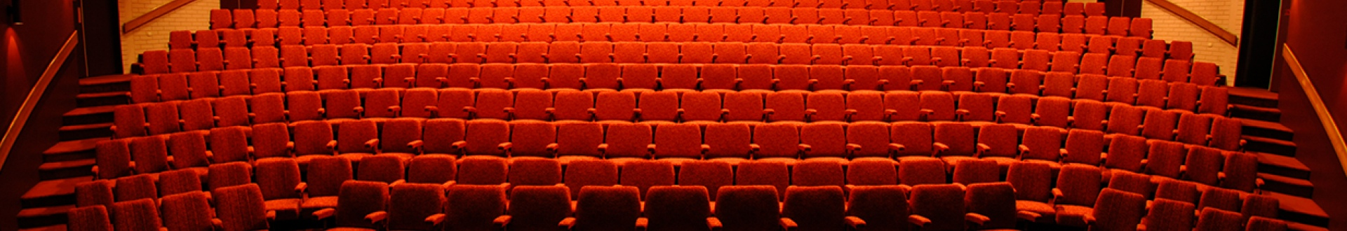 looking at auditorium from stage full of red seats